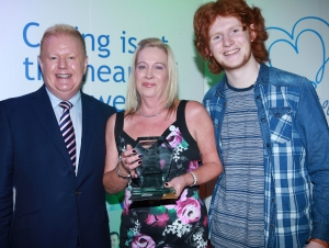 Outstanding Achiever and Overall Heart of Peninsula Care Rosemary Watson pictured with UTV's Julian Simmons and local star of BBC The Voice Conor Scott